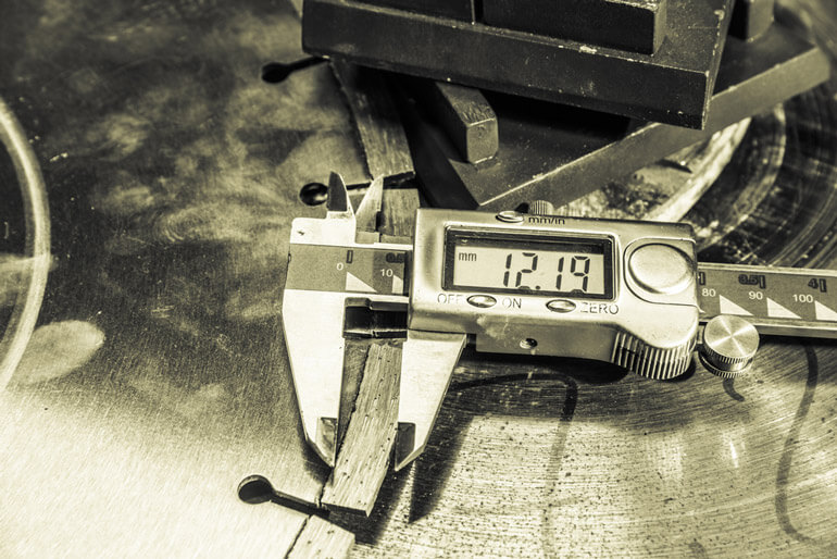 Digital caliper lying on a surface