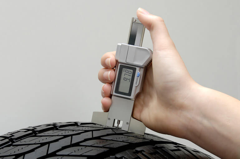 Digital Depth Gauge in a tire