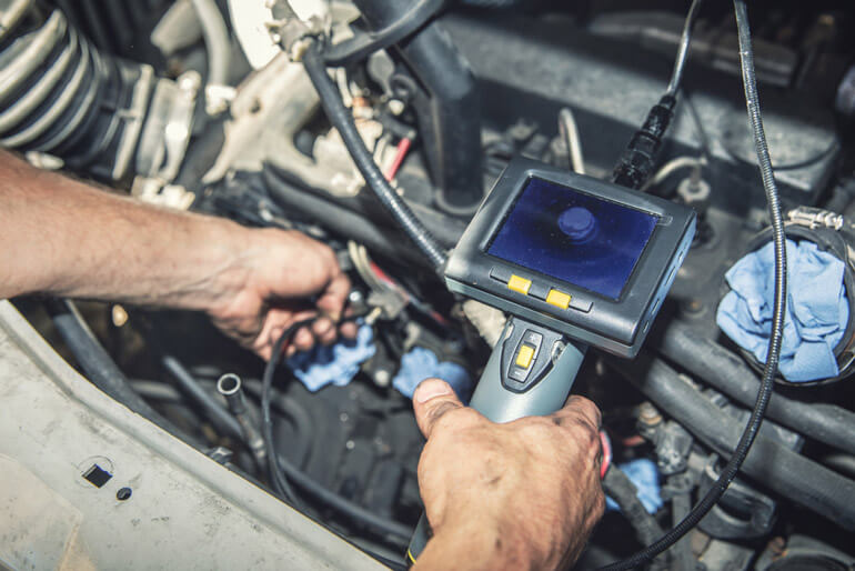 Man holds Inspection Camera to check his car