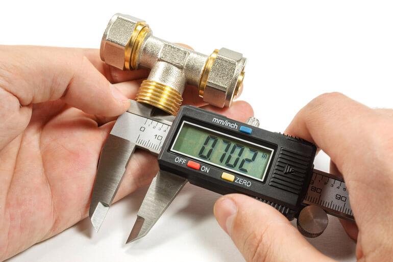 Measurement of plumbing fitting with digital caliper