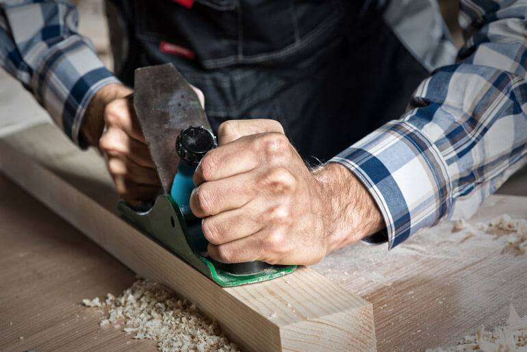 carpenter uses Hand Plane Sole Check Gauge