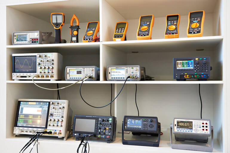 digital measuring tools on shelves