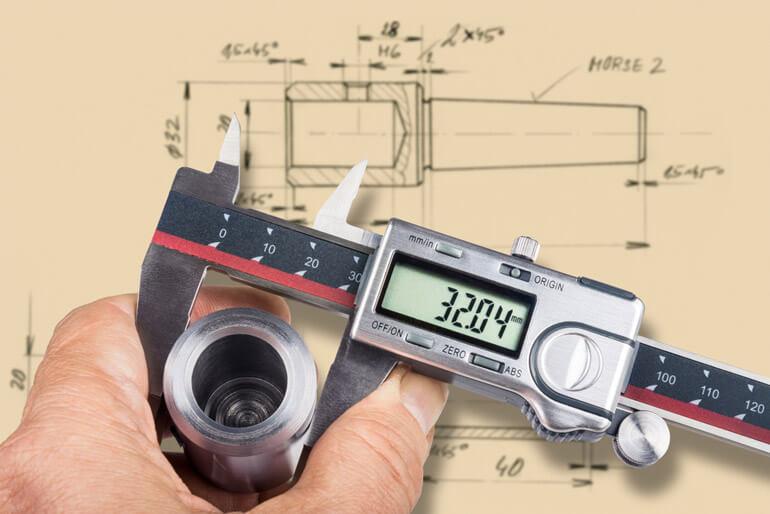 engineer checks the diameter of metal workpiece
