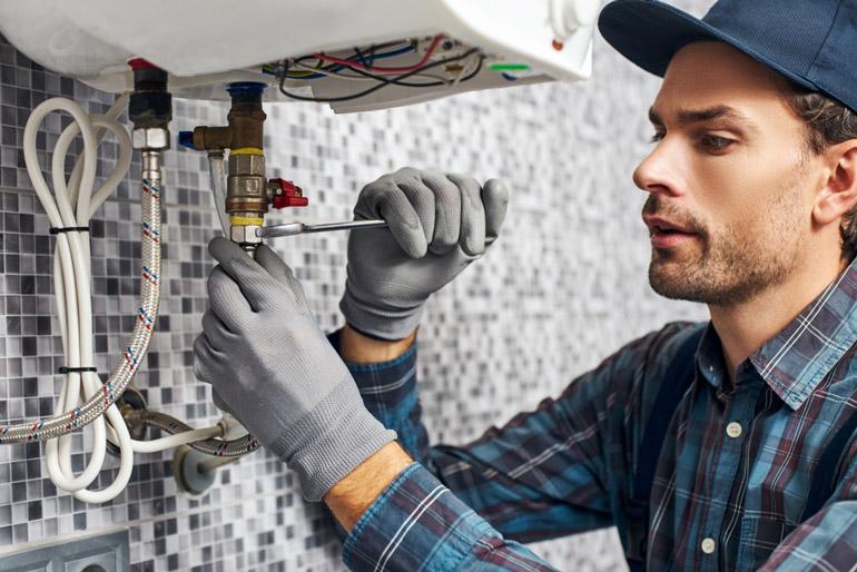 handyman installing home heating
