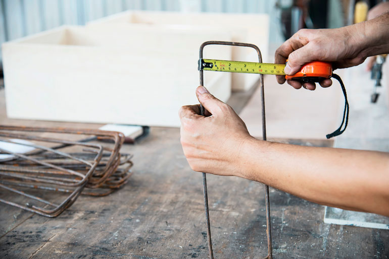 man using measuring tape